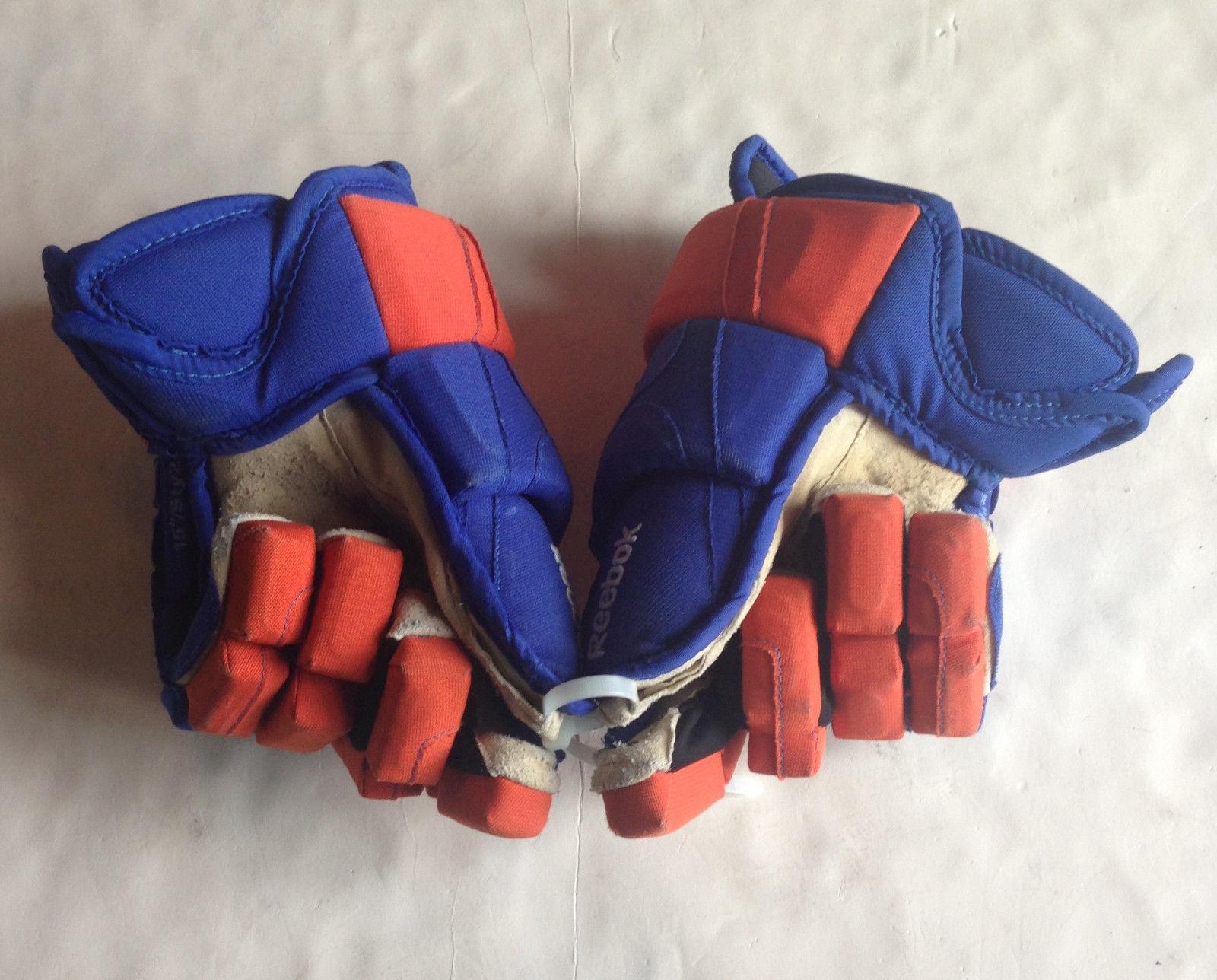 Brock Nelson #29  New York Islanders game used Reebok Hockey gloves pair CBM COA