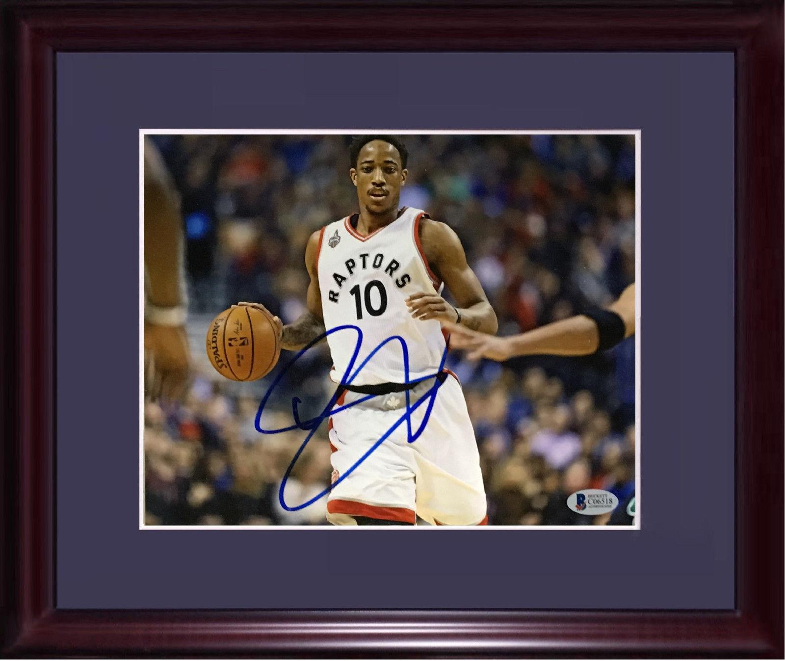 Demar Derozan Toronto Raptors signed 11×14 photo framed auto Beckett BAS COA